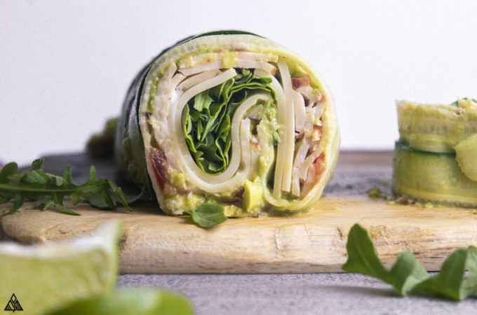 a slice of cucumber wrap on a wooden board
