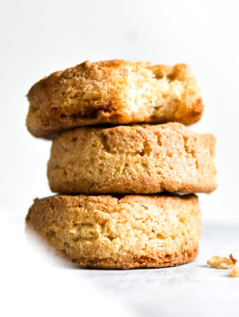 keto biscuit stacked and a bite taken out of it