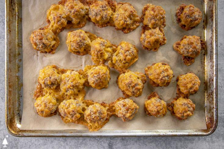 Top view of keto sausage balls on a baking sheet