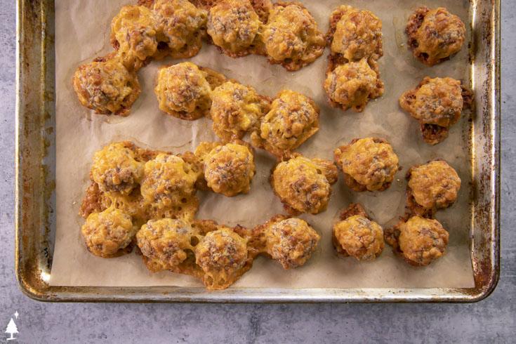 Low carb sausage balls on a baking sheet