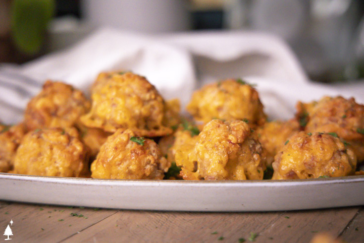 Side view of low carb sausage balls on a plate