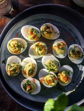 top view of delish avocado deviled eggs on a plate