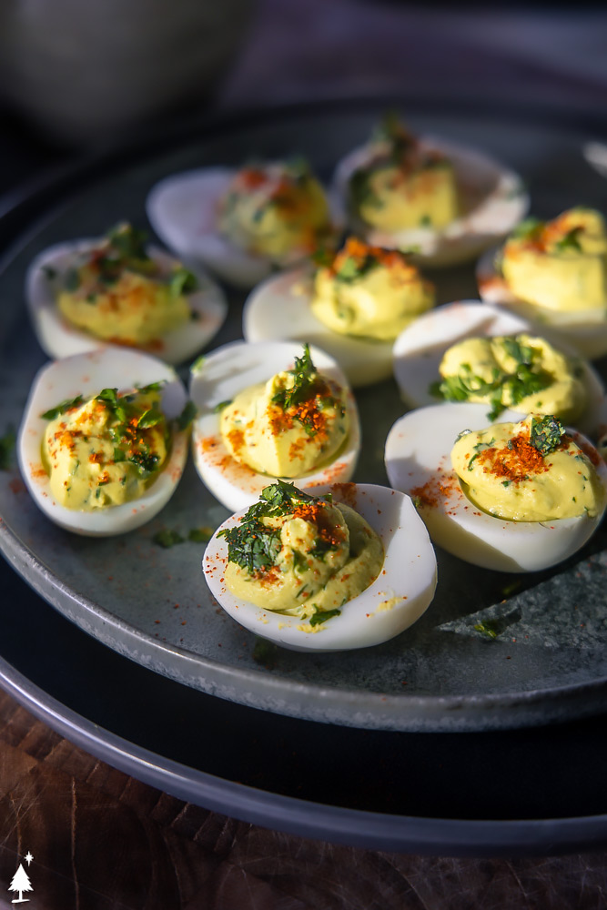 closer view of avocado deviled eggs without mayo on a plate