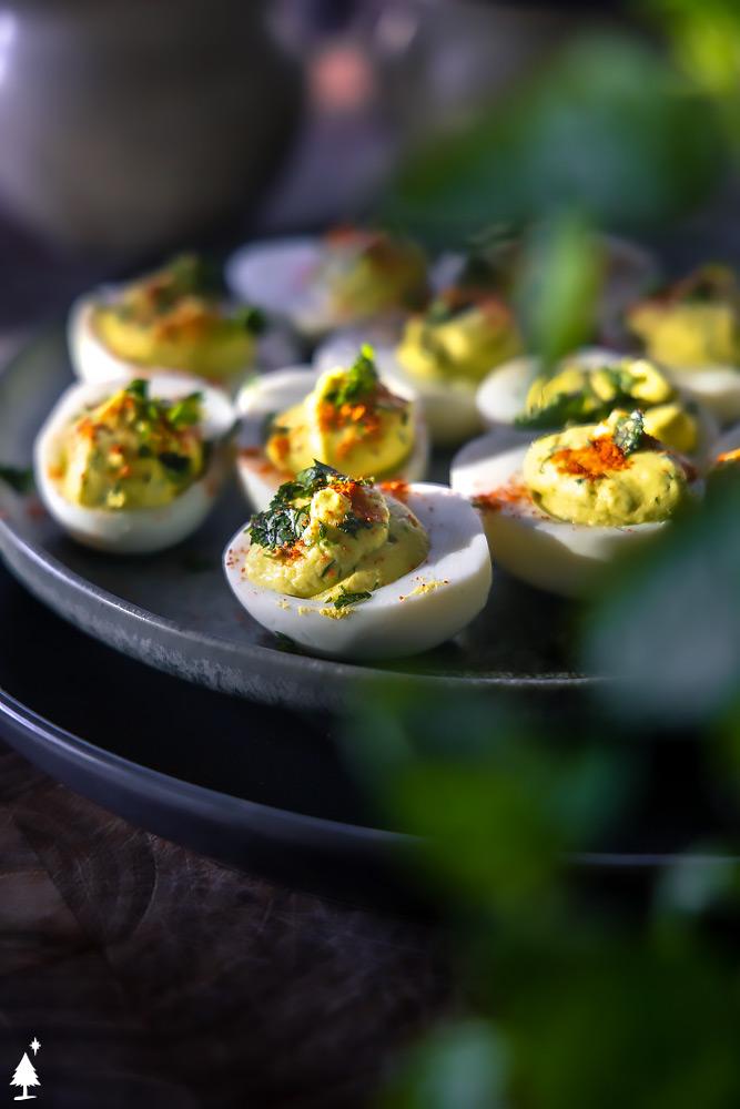 closer view of easy avocado deviled eggs recipe on a plate