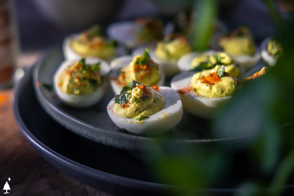 closer view of keto avocado deviled eggs on a plate