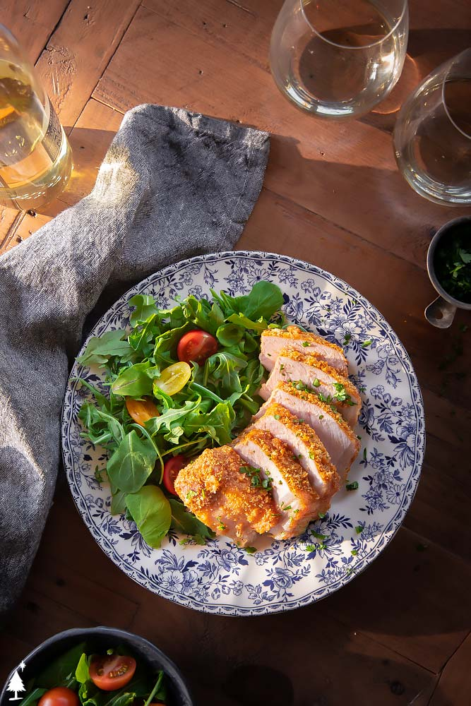 top view of parmesan pork chops on a plate
