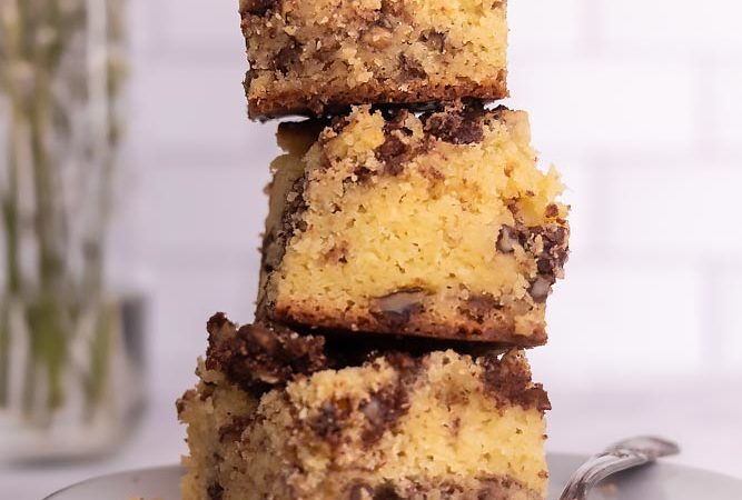 a stack of keto coffee cake slices on a plate