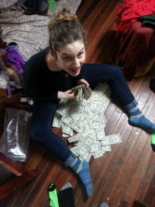 Lara Russo with the cash found stashed in the couch