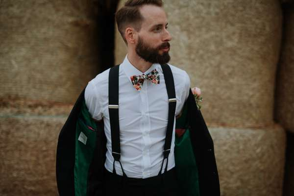 Groom wearing liberty print flower bow tie