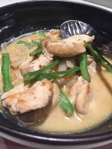 chicken with broth and beans inside bowl