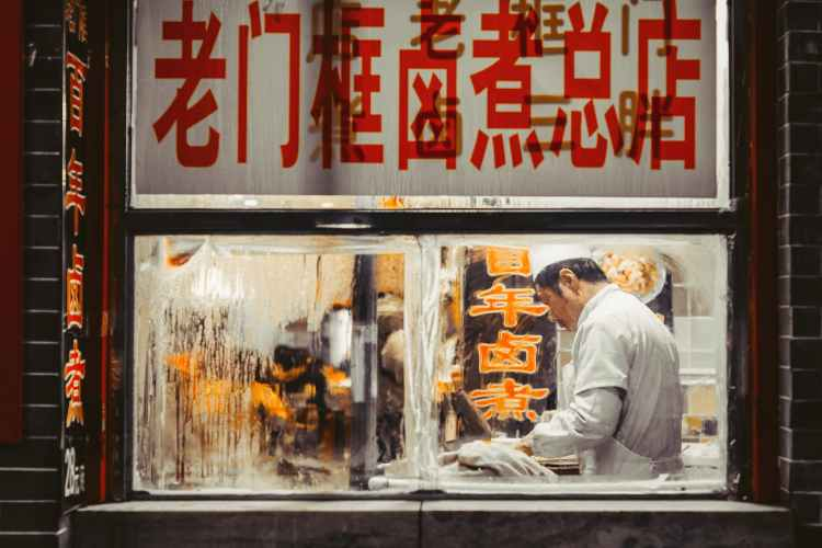 man working inside the kitchen