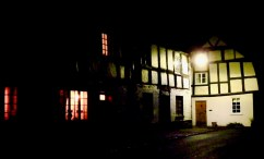 Black and white houses in street light