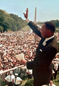 """FOR USE ANYTIME - Dr. Martin Luther King Jr. acknowledges the crowd at the Lincoln Memorial for his """"I Have a Dream"""" speech during the March on Washington, D.C. Aug. 28, 1963. Thursday April 4, 1996 will mark the 28th anniversary of his assassination in Memphis, Tenn. The Washington Monument is in background. (AP Photo/File)"""