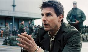 Tom Cruise begs for attention -- and gets it -- in Edge of Tomorrow (photo courtesy of Warner Brothers)