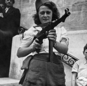 'Nicole'_a_French_Partisan_Who_Captured_25_Nazis_in_the_Chartres_Area,_in_Addition_to_Liquidating_Others,_Poses_with..._-_NARA_-_5957431_-_cropped