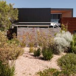 Architecture Set Within A Landscape Dominated By Coastal Heath