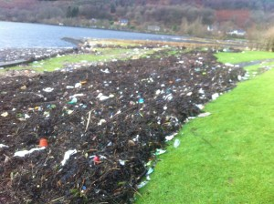 Huge mounds of debris were washed up - this is the scene by Loch Long at Arrochar