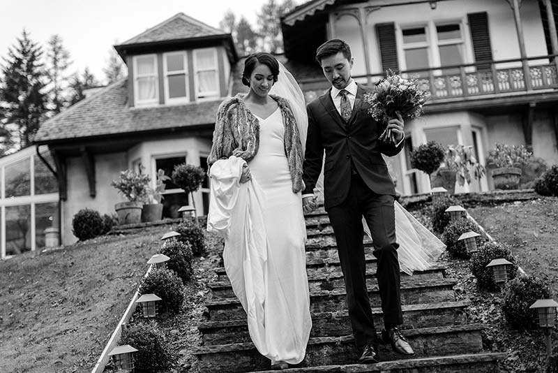 The happy couple descending the steps at the Lodge