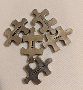 photo of silver puzzle pieces