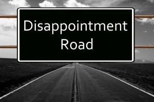 traffic sign that says disappointment road