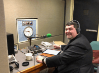 Photograph of Fr Matthew in radio studio at microphone