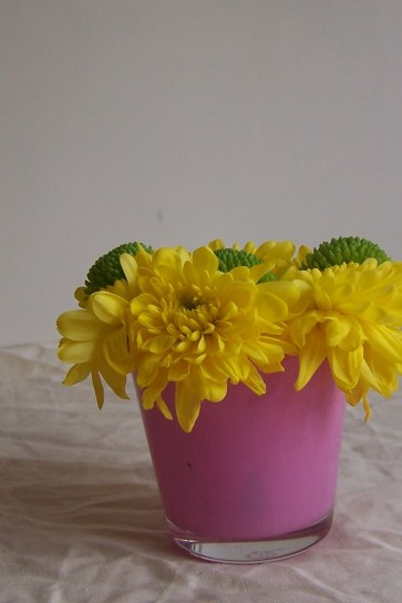 yellow and green flowers in pink vase the London flower lover