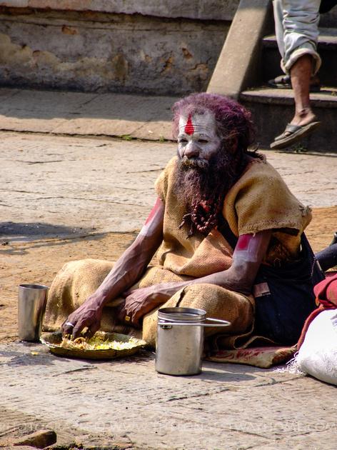 Sadhu eating dal bhat