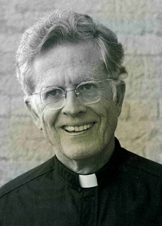 portrait shot of Fr Richard M Thomas S.J.