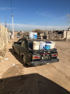 Francisco's sedan loaded with water