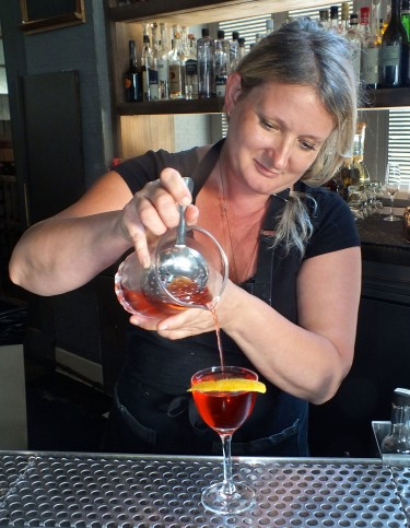 Gaby pouring a cocktail.  Photo by Edward simon for The Los Angeles Beat.