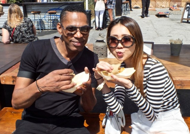 Two guests enjoying tacos. Photo by Ed Simon for The Los Angeles Beat.
