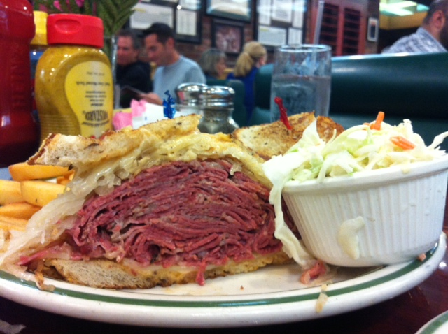 Juicy slices of heaven on a plate:  Brent's Deli's decadent rueben sandwich, ready to make you want to take a well earned nap. (Photo by Aileen Fraser)