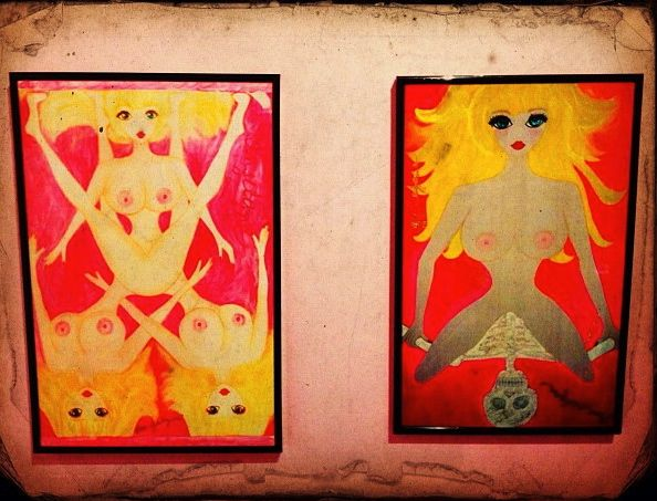 Two of Angelyne's paintings on display at The Burgundy Room during a show in the Fall 2012 (photo by Nikki Kreuzer)