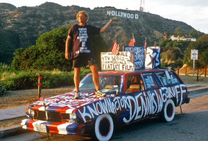 Dennis Woodruff stands atop one of his fabulous art cars. Photo by Harrod Blank at www.artcaragency.com