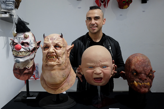 Danny Fuentes of Lethal Amounts and some of the Halloween masks on display