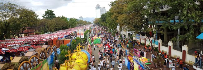 Osmena Boulevard, crowded with people, stalls and performers.