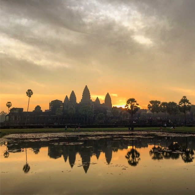 The iconic sunrise over Angkor Wat