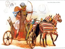 egyptian pharaoh wearing armor inside his chariot