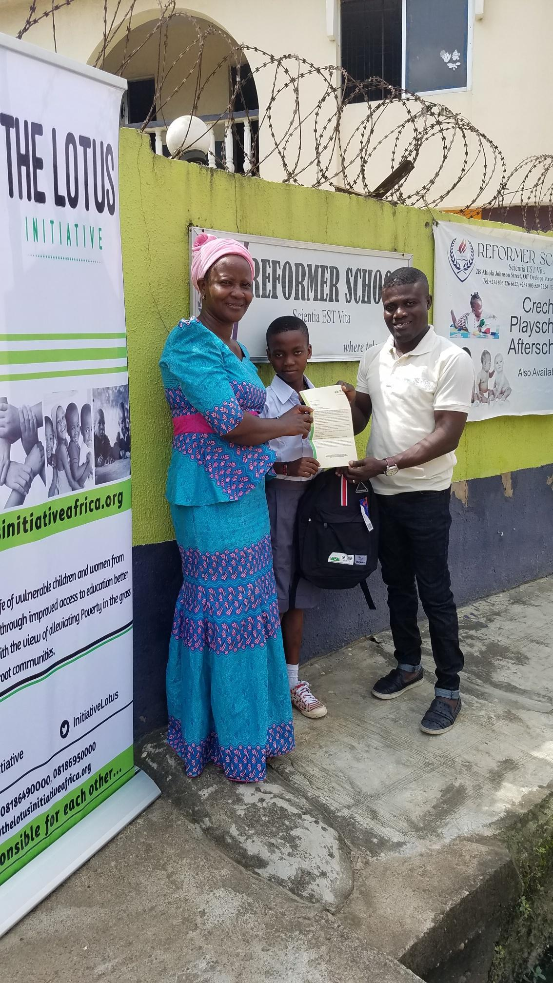 Lotus Initiative Manager with Master Samuel Kareem with his Mother.