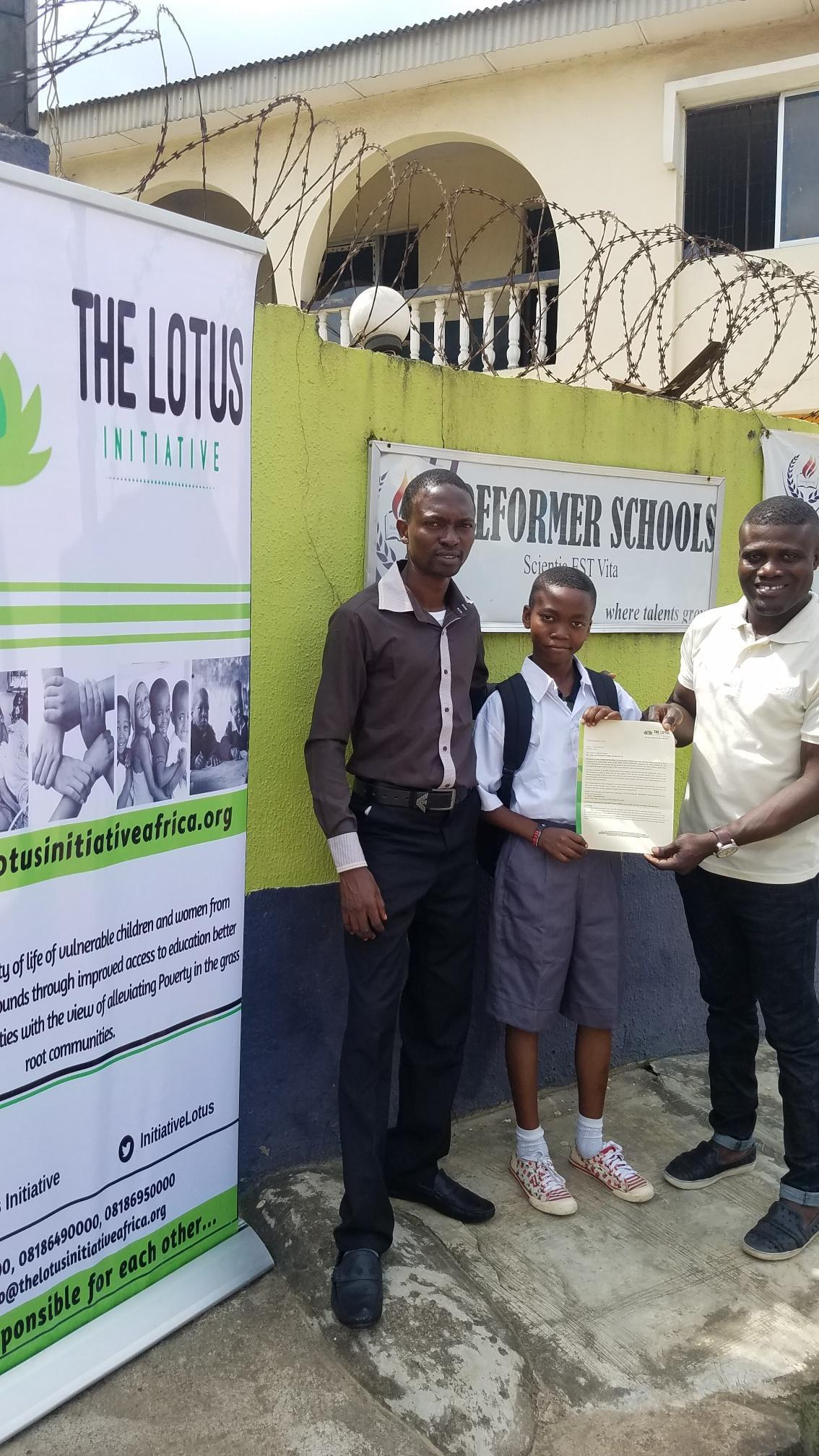 Lotus Initiative Manager presenting scholarship offer letter to Master Samuel Kareem of Reformer College with a staff.