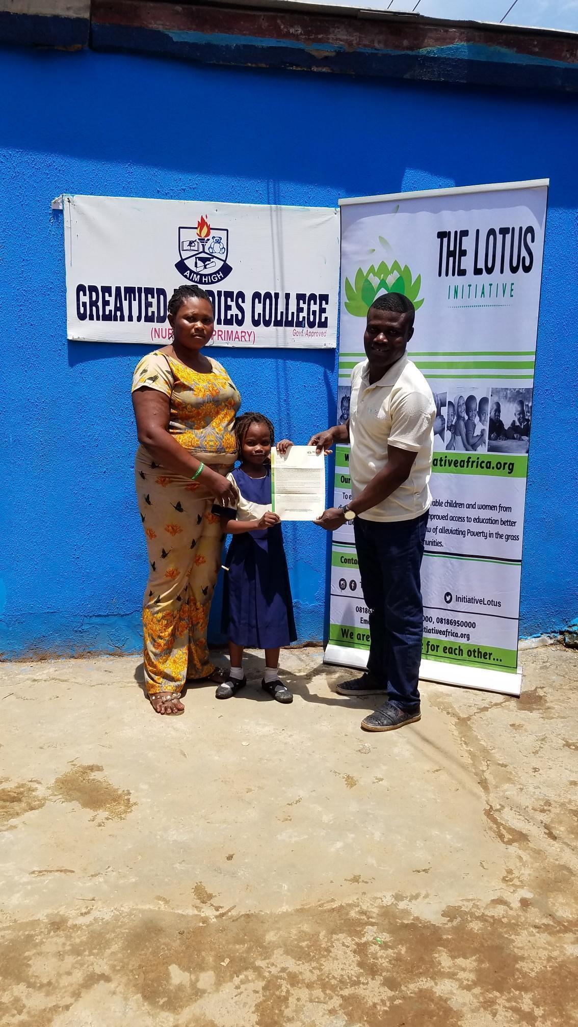 Mrs. Popoola with Scholar Kolapo Popoola and Lotus Initiative Program Manager.