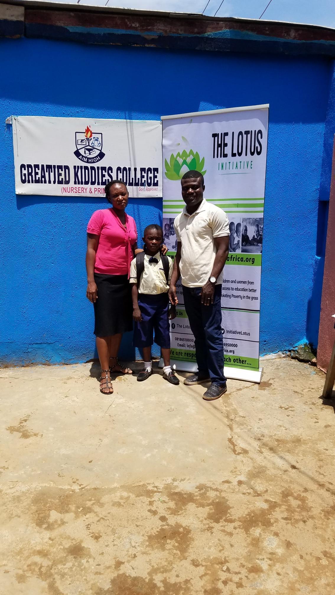 Lotus Program Manager, Lotus Scholar David Oyegoke with staff of Greatied Comprehensive School.