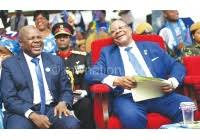 Everton Chimulilenji laughs with Mutharika at a rally