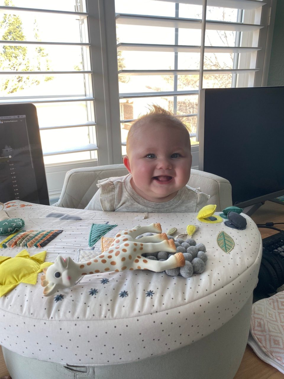 happy baby in her activity chair