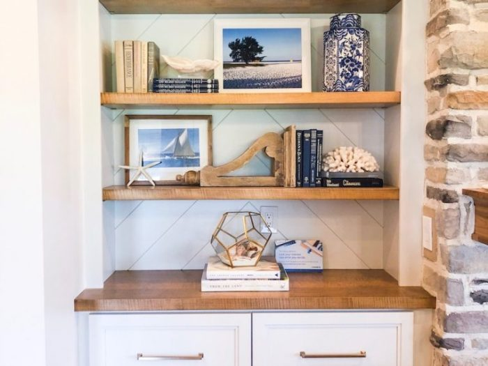 Use books and other pieces to artfully create an appealing display
