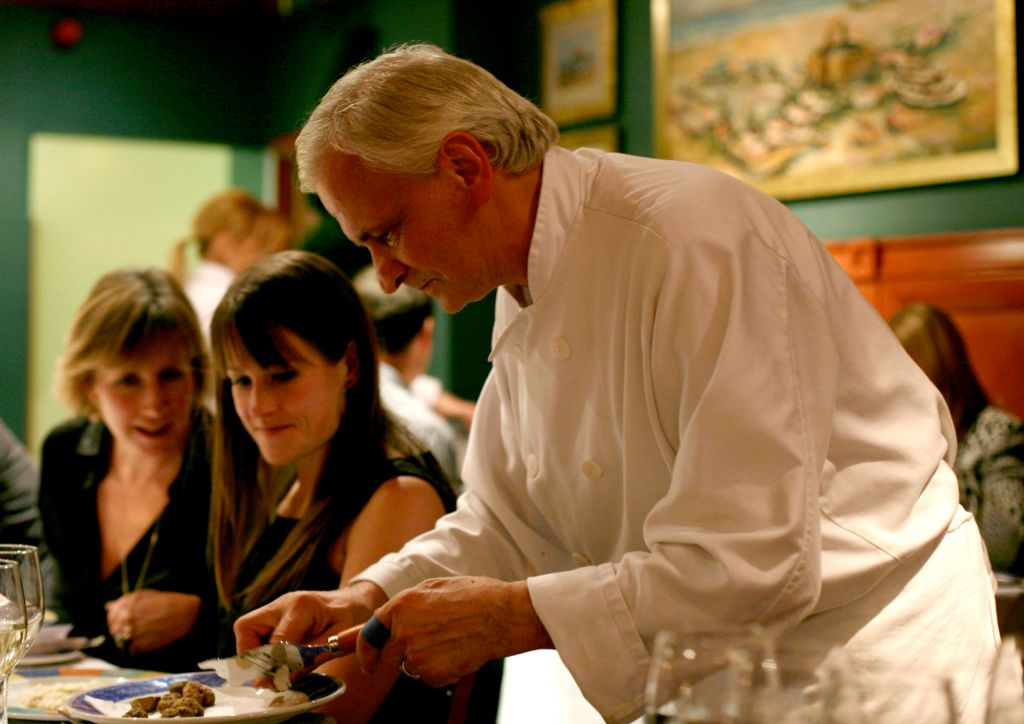 An Italian chef preparing a truffle for diners (Image: wikipedia)