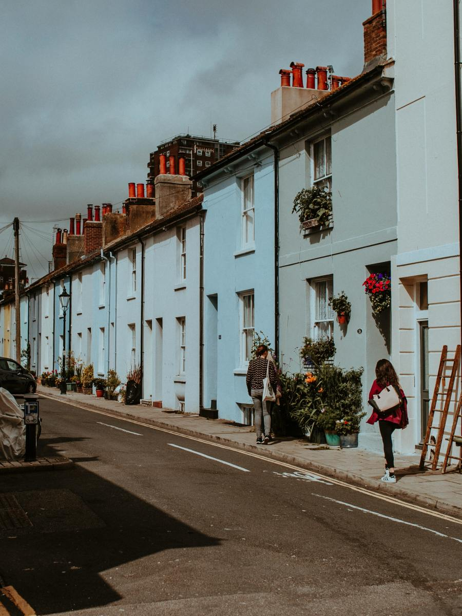 Street of colourful houses in Brighton - one of the greenest towns.
