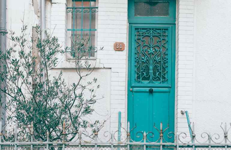 ornamental entrance door of old house in city