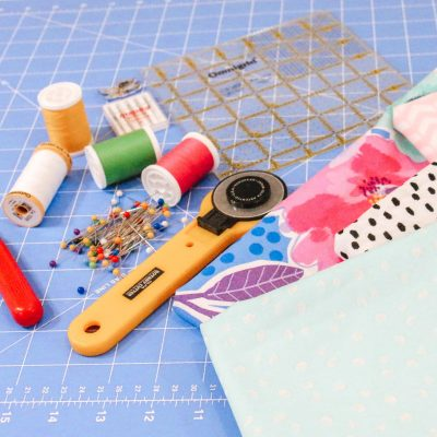 sewing notions for beginner quilter rotary cutter seam ripper Omnigrid ruler thread pins