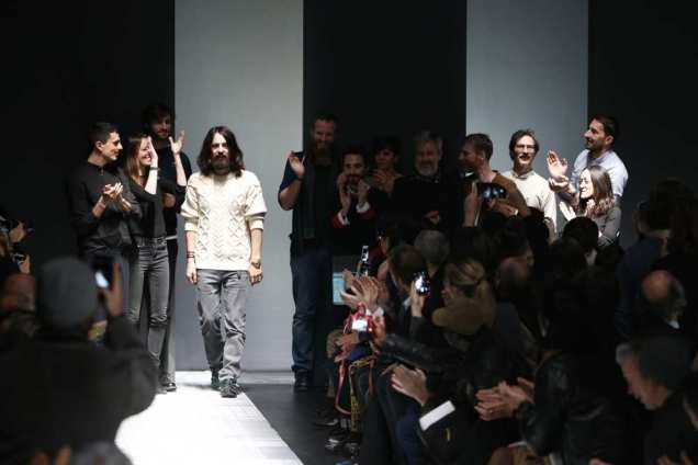 Alessandro Michele very much looking like Jesus surrounded by his twelve apostles after his fw15 menswear collection in Milan